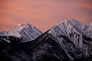 Quail Mountain, left, and Twin Peaks slice into the pink morning sky as they rise above Twin Lakes, Colorado.