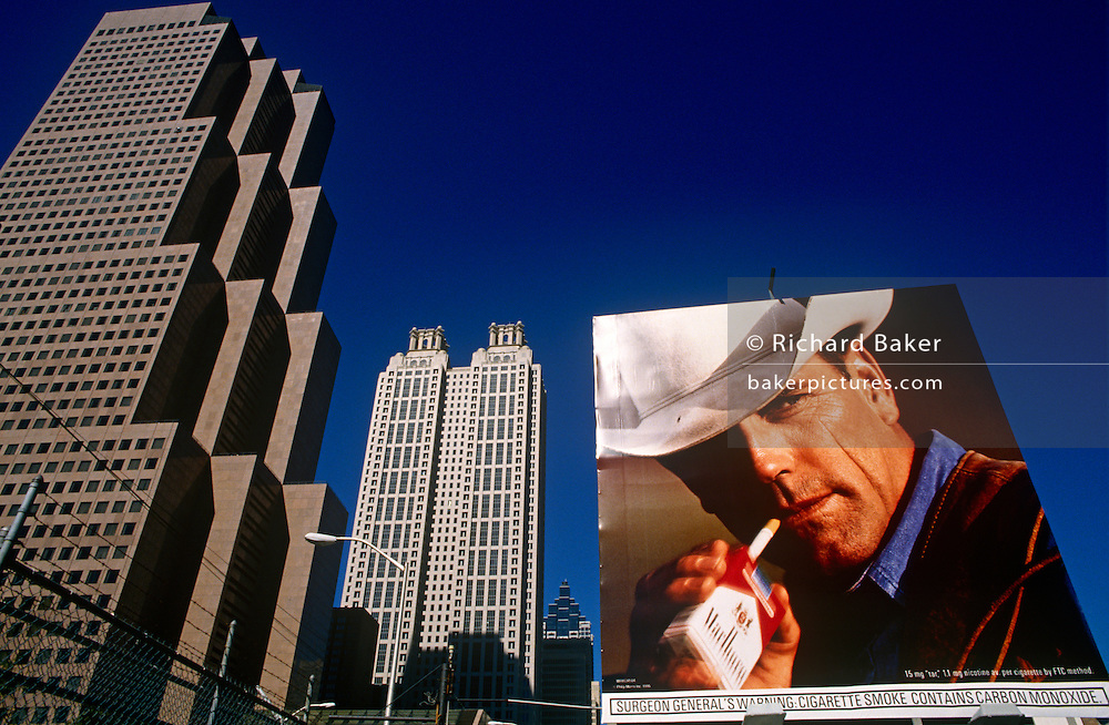 A Phillip Morros ad using the famous Marlboro Man cowboy character on a downtown Atlanta billboard. The Marlboro Man is a figure used in tobacco advertising campaign for Marlboro cigarettes. In the United States, where the campaign originated, it was used from 1954 to 1999. The Marlboro Man was first conceived by Leo Burnett in 1954. The image involves a rugged cowboy or cowboys, in nature with only a cigarette. The advertisements were originally conceived as a way to popularize filtered cigarettes, which at the time were considered feminine. The Marlboro advertising campaign, created by Leo Burnett Worldwide, is said to be one of the most brilliant advertisement campaigns of all time.