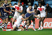 Scotland's Liam Hood (9 Leigh Centurions) is swamped as he tries to find a way through the England defence during the Ladbrokes Four Nations match between England and Scotland at the Ricoh Arena, Coventry, England on 5 November 2016. Photo by Craig Galloway.