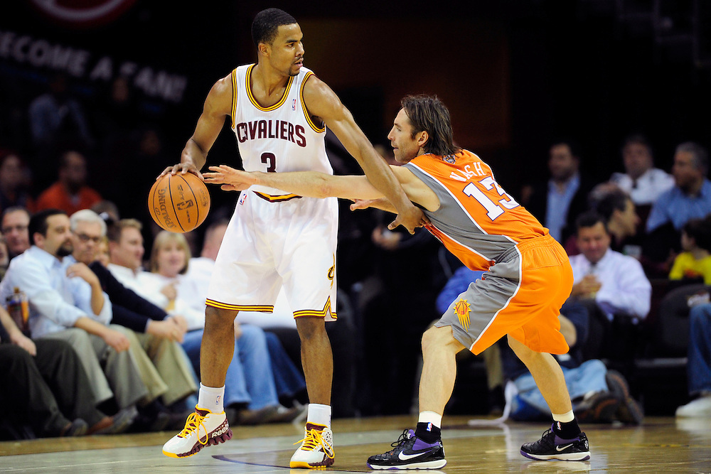 Jan. 19, 2011; Cleveland, OH, USA; Cleveland Cavaliers point guard Ramon Sessions (3) looks for a pass as Phoenix Suns point guard Steve Nash (13) tries to make a steal during the first quarter at Quicken Loans Arena. Mandatory Credit: Jason Miller-US PRESSWIRE