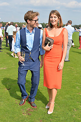 LUKE TREADAWAY and GEMMA ARTERTON at the Audi International Polo at Guards Polo Club, Windsor Great Park, Egham, Surrey on 26th July 2014.