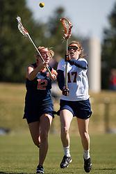 Virginia Cavaliers M Brittany Kalkstein (17) and Syracuse Orange M Christina Dove (12).  The #2 ranked Virginia Cavaliers women's lacrosse team defeated the #4 ranked Syracuse Orange 13-8 at the University of Virginia's Klockner Stadium in Charlottesville, VA on March 1, 2008.