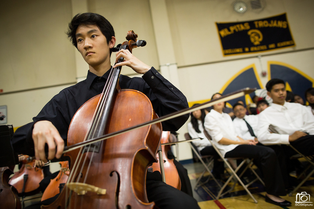Gordon Luu, MHS senior, plays the Cello during the Milpitas Unified School District's 11th Annual Music Festival at Milpitas High School in Milpitas, California, on April 10, 2014. (Stan Olszewski/SOSKIphoto)