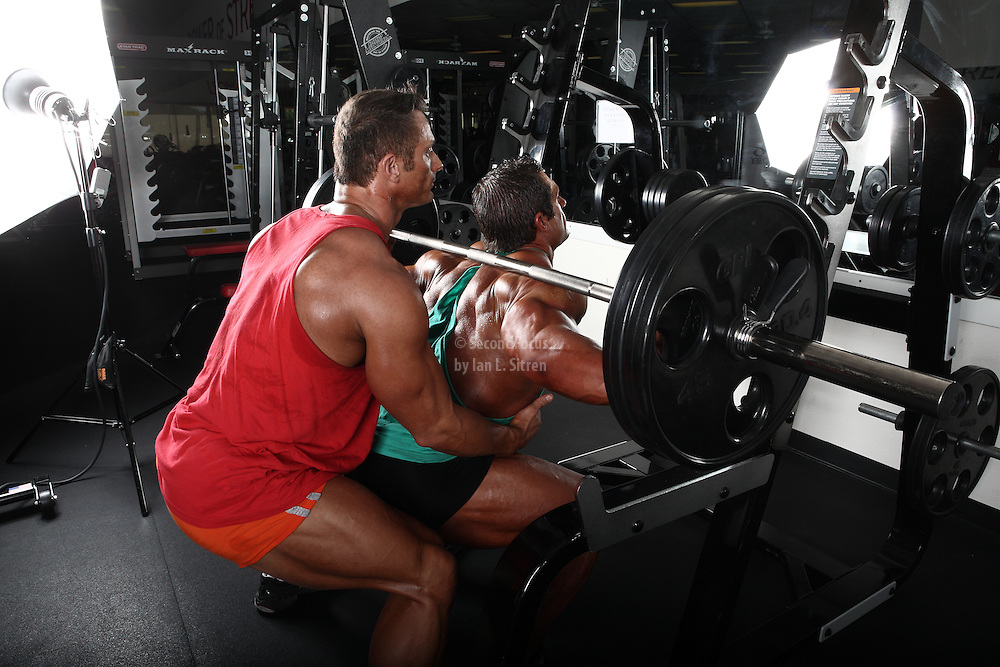 Bodybuilders Dan Decker and Brian Yersky doing squats.