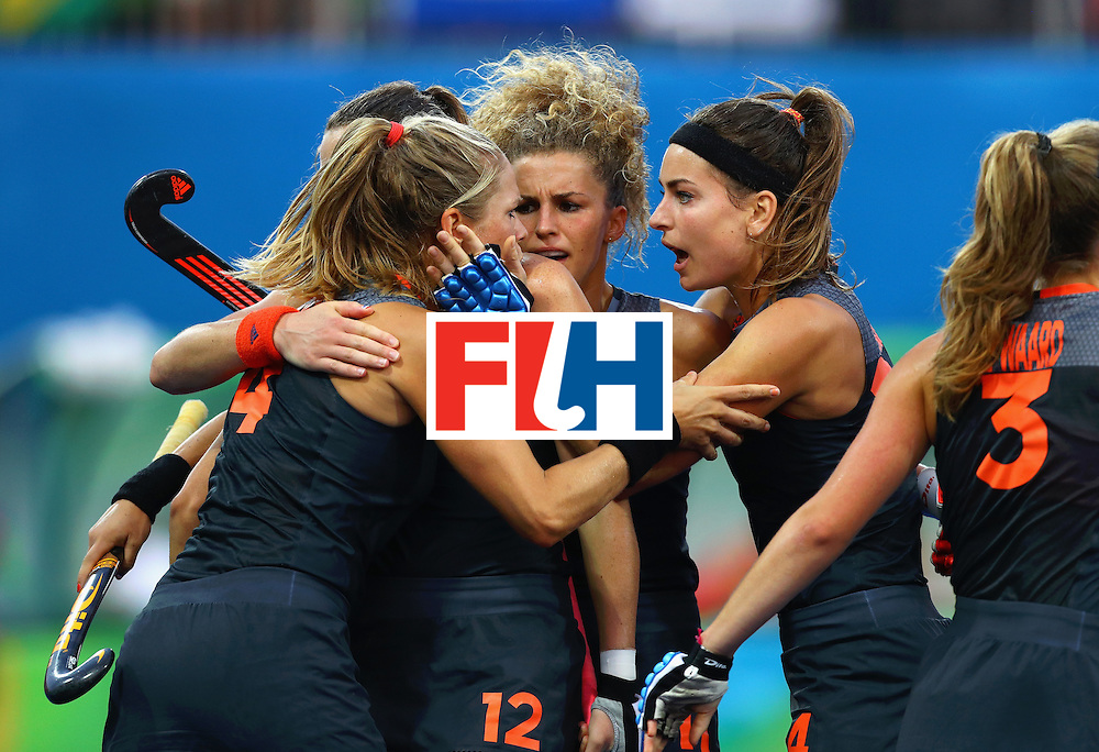 RIO DE JANEIRO, BRAZIL - AUGUST 19:  Kitty van Male of Netherlands (l) celebrates with teammates after scoring the equalising goal to make the score 1-1 during the Women's Gold Medal Match against the Netherlands on Day 14 of the Rio 2016 Olympic Games at the Olympic Hockey Centre on August 19, 2016 in Rio de Janeiro, Brazil.  (Photo by Tom Pennington/Getty Images)