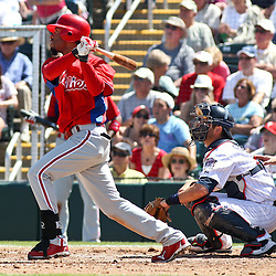 March 13, 2011; Fort Myers, FL, USA; Philadelphia Phillies shortstop Wilson Valdez (21) connects on a two run double during a spring training exhibition game against the Minnesota Twins at Hammond Stadium.   Mandatory Credit: Derick E. Hingle