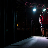 Caleb Everson of Olive Branch walks to the ring after his name is announced on Saturday, August 5th at the start of the Summit Fighting Championships match at the Tupelo Furniture Market. Everson fought in one of the title matches of the night against Austin Childers.