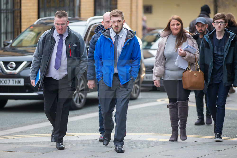 """© Licensed to London News Pictures. 05/02/2018. Liverpool, UK. Tom Evans (centre, blue coat) father of Alfie Evans arrives at Liverpool Civil & Family Court this morning with supporters. Tom Evans and Kate James from Liverpool are in dispute with medics looking after their son 19-month-old son Alfie Evans, at Alder Hey Children's Hospital in Liverpool. Alfie is in a """"semi-vegetative state"""" and had a degenerative neurological condition doctors have not definitively diagnosed. Specialists at Alder Hey say continuing life-support treatment is not in Alfie's best interests but the boy's parents want permission to fly their son to a hospital in Rome for possible diagnosis and treatment. Photo credit: Andrew McCaren/LNP"""