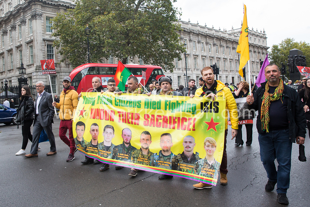 London, UK. 13 October, 2019. Kurdish supporters of the YPG march past Downing Street in protest against Turkey's invasion of Kurdish-held territory in north-eastern Syria.
