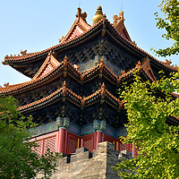 Southeast Corner Tower at Forbidden City in Beijing, China<br /> The moat around the Forbidden City is a rectangle measuring over 2.3 miles long and 20 feet deep. Protecting the four corners are towers called Jiao lou. This is the Southwest Corner Tower on your approach to Meridian Gate. The original wooden defenses were constructed within three months during 1420. The intricate, 72 ridge roofline is patterned after the Pavilion of Prince Teng, constructed in Nanchang, China in 653 AD. Tengwang Pavilion is one of the Three Great Towers of southern China.