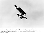 David Kirke flying a microlight during a Dangerous Sports Club Tea party. Given at the Gloucestershire home of the Dutch Ambassador Robbert Fack. 22 August 1981. Film 818196f40<br />