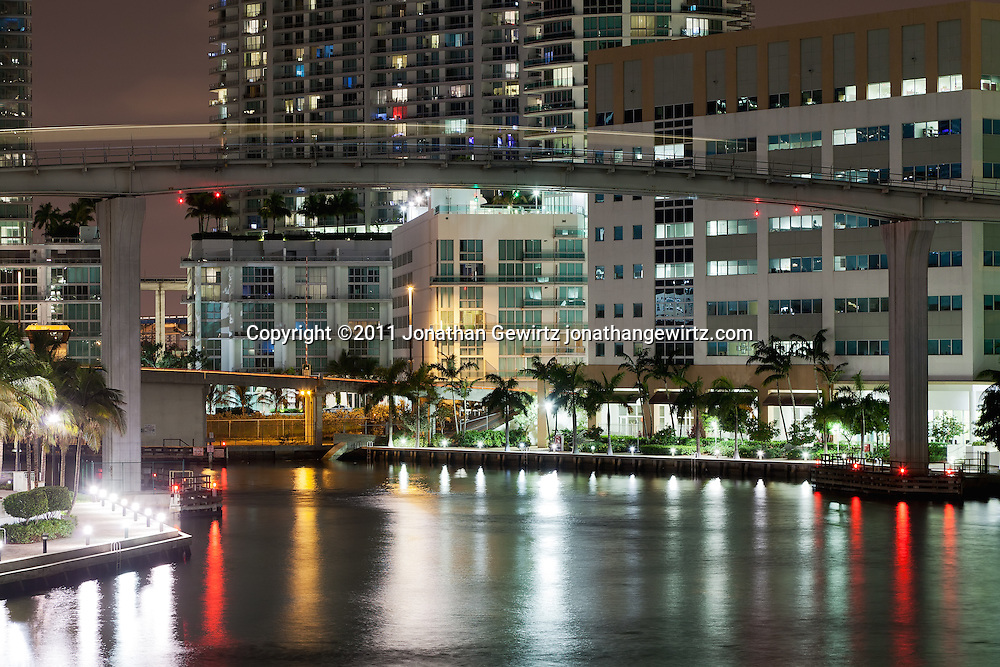 A Miami Metromover automated train car crosses the Miami River at night. WATERMARKS WILL NOT APPEAR ON PRINTS OR LICENSED IMAGES.
