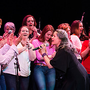 Natalie Merchant performs with women from the audience in the 2014 Portsmouth Singer Songwriter Festival at The Music Hall in Portsmouth, NH, on April 12, 2014