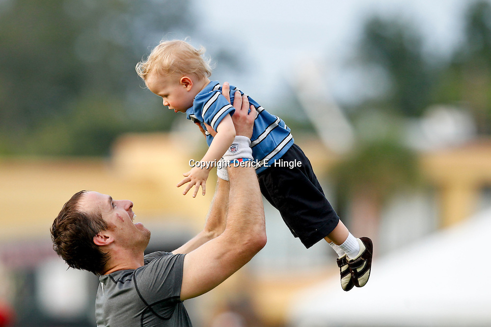 July 28, 2012; Metairie, LA, USA; New Orleans Saints quarterback Drew Brees holds up his son Bowen Brees following a training camp practice at the team's practice facility. Mandatory Credit: Derick E. Hingle-US PRESSWIRE