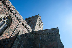 Exterior of the medieval church, Iona Abbey..Iona is a small island in the Inner Hebrides off the western coast of Scotland. It was a centre of Irish monasticism for four centuries and is today renowned for its tranquility and natural beauty..©Michael Schofield..
