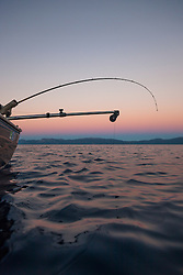 """Sunset Fishing on Lake Tahoe 8"" - Photograph of a fishing pole and downrigger at sunset on Lake Tahoe, on the East Shore."