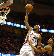 PHOTO BY DAVID RICHARD.LeBron James of Cleveland is fouled by Washington's Caron  Butler yesterday in the second half.