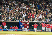 CULIACAN, MEXICO - FEBRUARY 7, 2017: The Puerto Rican team erupts out of the dugout after Mexico fails to bring home a tying run in the bottom of the tenth inning, winning the the Caribbean Series championship game at Estadio de los Tomateros on February 8, 2017 in Culiacan, Rosales. (Photo by Jean Fruth)