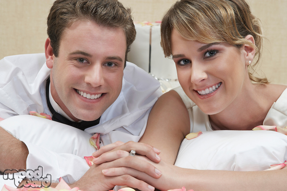 Bride and groom relaxing among presents, portrait, close-up