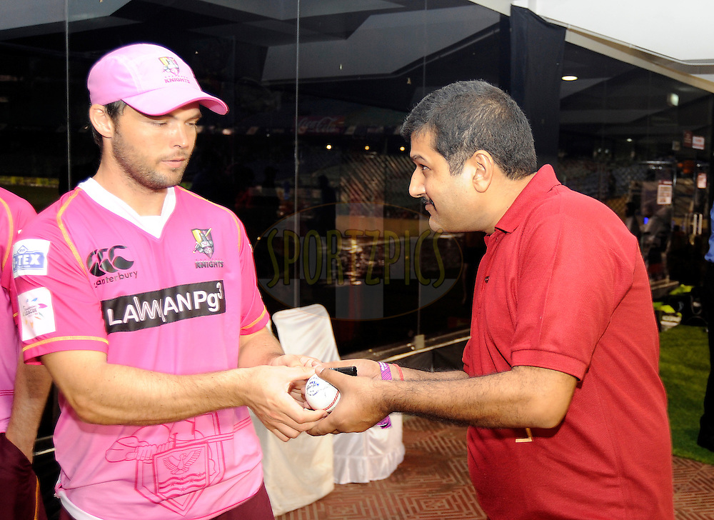 Daniel Flynn Captain of Northern Knights signs the ball for the Royal stag Fan of the match award during match 3 of the Oppo Champions League Twenty20 between the Cape Cobras and the Northern Knights held at the Chhattisgarh International Cricket Stadium, Raipur, India on the 19th September 2014<br /> <br /> Photo by:  Pal Pillai / Sportzpics/ CLT20<br /> <br /> <br /> Image use is subject to the terms and conditions as laid out by the BCCI/ CLT20.  The terms and conditions can be downloaded here:<br /> <br /> http://sportzpics.photoshelter.com/gallery/CLT20-Image-Terms-and-Conditions-2014/G0000IfNJn535VPU/C0000QhhKadWcjYs