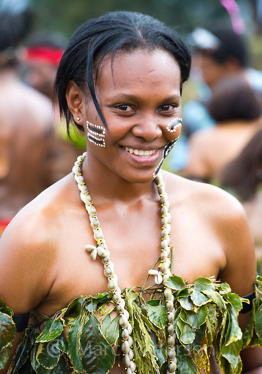 Portrait of a young woman from Milne bay province dressed in traditional tribal dress for the Goroka Show, an annual Singsing Festival in the highlands of Papua New Guinea