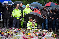 © Licensed to London News Pictures. 06/06/2017. London, UK.  Flowers being places before a minutes silence is held at London Bridge in central London for those who lost their life in a terrorist attack on Saturday evening. Three men attacked members of the public  after a white van rammed pedestrians on London Bridge.   Ten people including the three suspected attackers were killed and 48 injured in the attack. Photo credit: Ben Cawthra/LNP