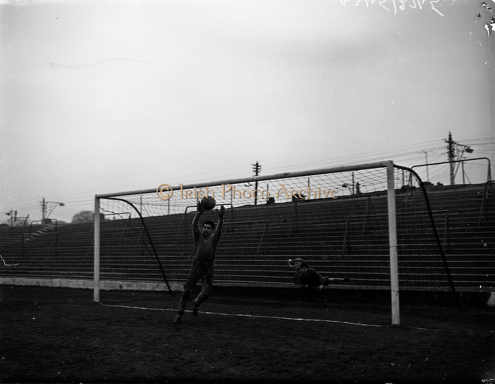 26/03/1960<br /> 03/26/1960<br /> 26 March 1960<br /> Chilean Soccer players practice at Milltown, before game with Ireland.Chilean Goalkeeper, Coloma brings off a good save during practice showing the stiff opposition Ireland would meet in their game on the 30 March.