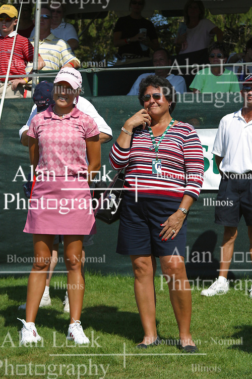 04 Sep 2005<br /> <br /> Natalie Gulbis and Nancy Lopez watch the awards ceremony together.<br /> <br /> LPGA State Farm Classic.  The Rail Golf Course, Springfield (Sherman) Illinois