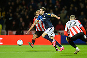 Nottingham  Forest player Yuri Ribeiro passes the ball under pressure from the Brentford defence in the first half during the EFL Sky Bet Championship match between Brentford and Nottingham Forest at Griffin Park, London, England on 28 January 2020.