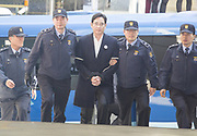 Vice chairman of Samsung Electronics and the de facto leader of Samsung Group Lee Jae-Yong arrives at the special prosecutors office in Seoul, South Korea, Feb 25, 2017. Special prosecutors questioned Lee on Saturday again since he was arrested over bribery allegations related with a corruption scandal that led to President Park Geun-hye's impeachment in December, 2016. The Seoul Central District Court issued an arrest warrant for Lee on Feb. 17, 2017. Lee faces allegations that he gave or promised some 43 billion won (US$36.3 million) worth of bribes to the president's friend Choi Soon-sil in return for the government's backing of a merger of two Samsung affiliates in 2015, local media reported. Photo by Lee Jae-Won (SOUTH KOREA) www.leejaewonpix.com