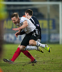 Livingston's Iain Russell tackled by Falkirk's Conor McGrandles..Falkirk 2 v 0 Livingston, 19/2/2013..©Michael Schofield.