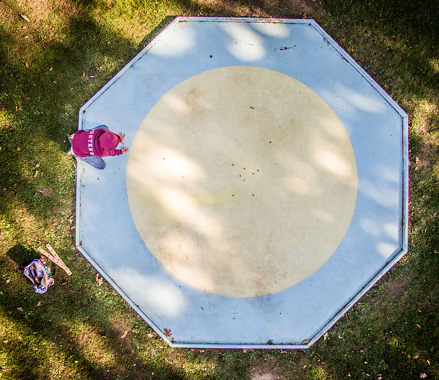 Aerial view of a boy playing with marbles in  Cumberland, Maryland.