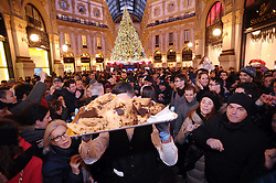 PANETTONE RECORD HIGH TWO METERS, THE BIGGEST OF THE WORLD, CREATED BY SAN GREGORIO PASTRY OF MILAN, WHICH HAS BEEN TAKEN AND OFFERED IN VITTORIO EMANUELE GALLERY. 17 Dec 2017 Pictured: cutting the panettone in the Galleria. Photo credit: Fotogramma / MEGA TheMegaAgency.com +1 888 505 6342