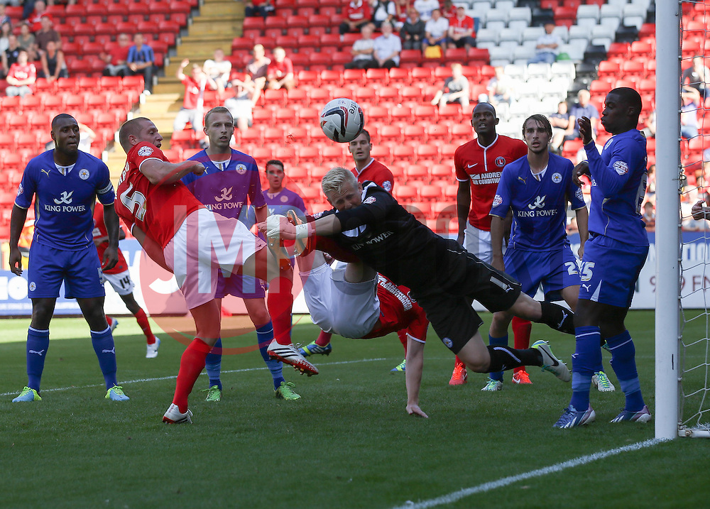 Leicester City's Kasper Schmeichel keeps out Charlton Athletic's Michael Morrison  - Photo mandatory by-line: Robin White/JMP - Tel: Mobile: 07966 386802 31/08/2013 - SPORT - FOOTBALL - The Valley - Charlton - Charlton Athletic V Leicester City - Sky Bet Championship