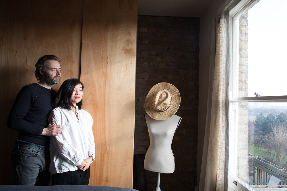 Simon and Taeko Astridge in the master bedroom of their newly renovated Tufnell Park flat in London. CREDIT: Vanessa Berberian for The Wall Street Journal. BALANCE SHEET - Astridge