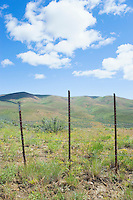 Fence along high desert hills on spring day Umptanum Ridge Eastern Washington USA