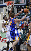 Feb. 28, 2012; Indianapolis, IN, USA; Golden State Warriors power forward David Lee (10) shoots the ball against Indiana Pacers center Roy Hibbert (55) at Bankers Life Fieldhouse. Indiana defeated Golden State 102-78. Mandatory credit: Michael Hickey-US PRESSWIRE