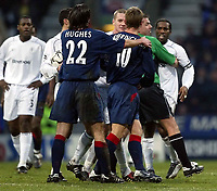 Photo. Aidan Ellis.<br />Bolton Wanderers v Portsmouth.<br />FA Barclaycard Premiership.<br />17/01/2004.<br />Bolton's Jay-Jay Okocha and Pompey's Teddy Sheringham get involved in an argument with each other