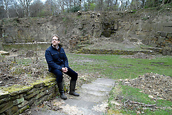 © Licensed to London News Pictures.  21/03/14.  Mirfield , UK. A community of monks has launched a £500,000 bid to restore a unique 19th century open-air theatre. The Quarry Theatre at the Community of the Resurrection, an Anglican religious retreat in Mirfield, W Yorks, was abandoned almost 40 years ago. Now general manager at the community, Guy Laurie (pictured), has had planning permission approved to restore the theatre and re-open it to professional companies and the local community. The natural amphitheater in the community's 20-acre grounds was created when stone was quarried to build a house. The quarry was turned into a theatre and as many as 6,000 people packed in to see plays and performances. Mirfield-born Hollywood actor Sir Patrick Stewart had his first stage experience in the theatre and high-profile politicians also addressed large crowds there. Keir Hardie, founder of the Labour movement, spoke there as did suffragette leader Emmeline Pankhurst. In the 1970s the community closed the theatre and it became overgrown.. Photo Credit: Sam Atkins/LNP
