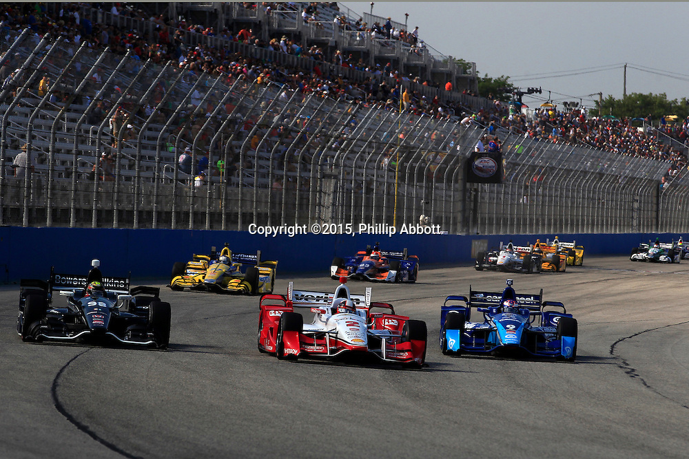 11-12 July, 2015, West Allis, Wisconsin USA<br /> Juan Pablo Montoya, Gabby Chaves and Scott Dixon battle going into turn one<br /> &copy;2015, Phillip Abbott<br /> LAT Photo USA