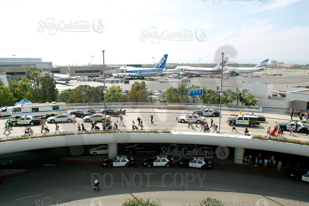 Jul 04, 2002; Los Angeles, CA, USA; Passengers return to the Tom Bradley International terminal at Los Angeles International airpor on the forth of July.<br />