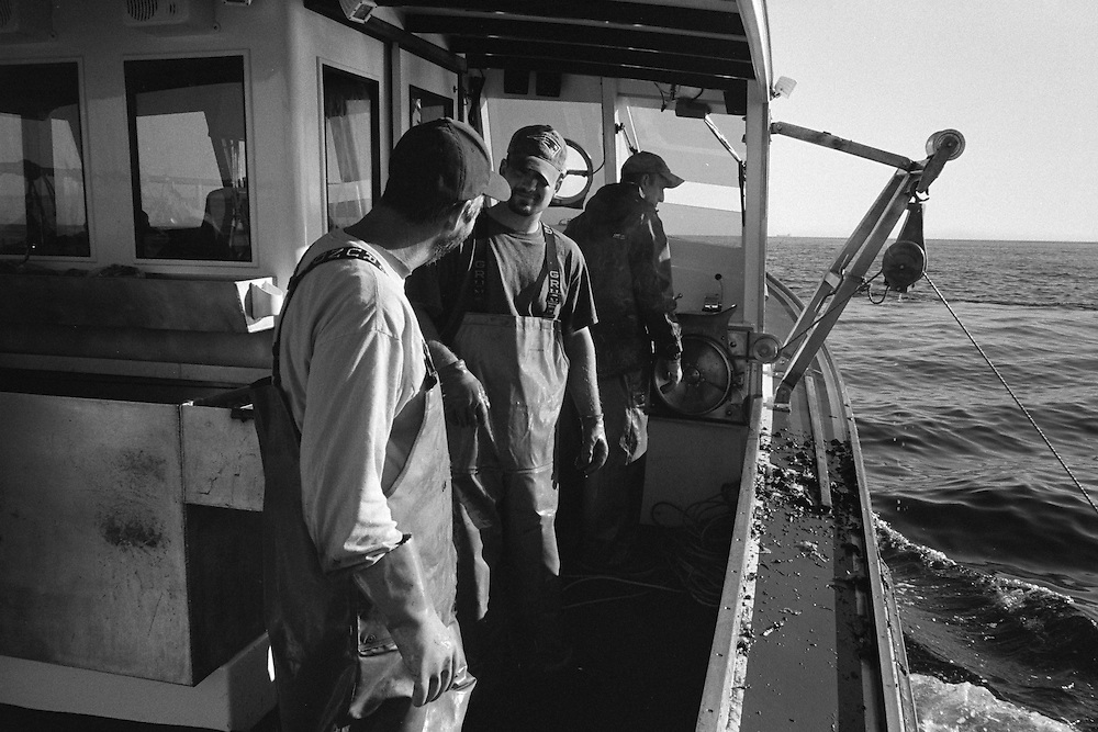 Ben Weed at the helm with his sternmen Doug Hansen and Ron Oliver. This side of the boat is where the traps are hauled in, harvested and reset.