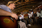 Canadian artist Dave Bidini (left) jams with members of the band King's Jubilee, Zaroe Amilcar (second left), Richard Neufville and Francis Wesseh (right) at the  Buduburam refugee settlement, roughly 20 km west of Ghana's capital Accra on Friday April 13, 2007. The group, which is composed of five Liberian men living at Buduburam, is currently recording their second album, and already has a growing number of fans back in Liberia. The Buduburam refugee settlement is still home over 30,000 Liberians, most of which have mixed feelings about returning to Liberia..