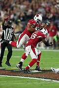 Arizona Cardinals nose tackle Corey Peters (98) leaps on and celebrates with Arizona Cardinals outside linebacker Chandler Jones (55) after Jones stuffs a second quarter run and forces a punt during the 2017 NFL week 3 regular season football game against the Dallas Cowboys, Monday, Sept. 25, 2017 in Glendale, Ariz. The Cowboys won the game 28-17. (©Paul Anthony Spinelli)