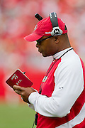 KANSAS CITY, MO - SEPTEMBER 26:   Head Coach Mike Singletary of the San Francisco 49ers writes in his book during a game against the Kansas City Chiefs at Arrowhead Stadium on September 26, 2010 in Kansas City, Missouri.  The Chiefs defeated the 49ers 31-10.  (Photo by Wesley Hitt/Getty Images) *** Local Caption *** Mike Singletary