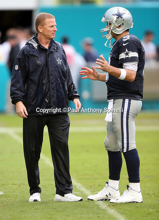 Dallas Cowboys quarterback Tony Romo (9) gestures as he talks to Dallas Cowboys head coach Jason Garrett before the 2015 week 11 regular season NFL football game against the Miami Dolphins on Sunday, Nov. 22, 2015 in Miami Gardens, Fla. The Cowboys won the game 24-14. (©Paul Anthony Spinelli)