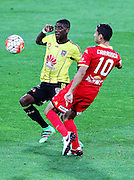 Phoenix' Roly Bonevacia & Adelaide United's Marcelo Carrusca compete for the ball during the Round 22 A-League football match - Wellington Phoenix V Adelaide United at Westpac Stadium, Wellington. Saturday 5th March 2016. Copyright Photo.: Grant Down / www.photosport.nz