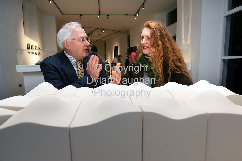 """2/12/2005.Pictured at the opening of the Craftmark 'Piece"""" exhibition at the Craft Council of Irelands National Craft Gallery in Kilkenny was from left Martin Walsh Chairman of the Crafts Council of Ireland and Frances Lambe  from Dundalk County Louth. Martin and Frances are pictured with work by Frances called """" Slab""""..Picture Dylan Vaughan.."""
