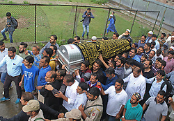 June 15, 2018 - Baramulla, Jammu and Kashmir, India - Coffin containing the dead body of senior journalist and editor of Rising Kashmir newspaper Shujaat Bukhari is being carried for last rites in Kreeri area of north Kashmir's Baramulla some 40 kilometeres from Srinagar the summer capital of Indian controlled Kashmir on June 15, 2018. Shujaat was shot dead along with his two personal security guards by unknown gunmen on Thursday evening on June 14  in press colony Srinagar. (Credit Image: © Faisal Khan via ZUMA Wire)