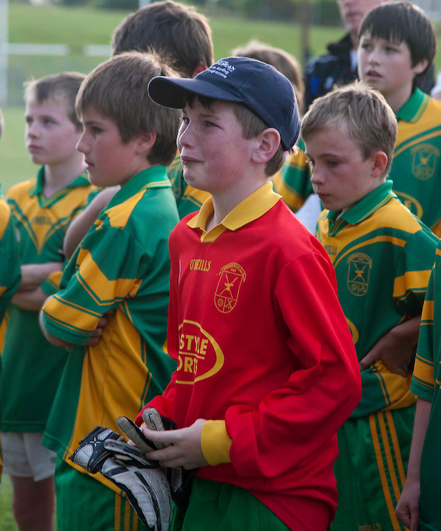 Curragha vs Slane Division 4 u-12 football league final at Pairc Tailteann_11/06/10.Curragha goalkeeper, Niall McLarnon sheds a tear as he watches the Slane team accept the cup in the division 4 u-12 final.Photo: David Mullen /www.cyberimages.net